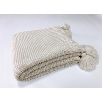 Plaid tricot avec pompoms...